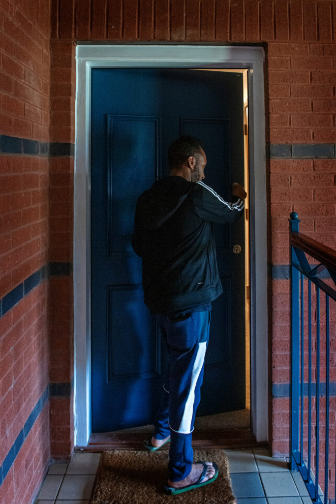 Asylum seeker in Glasgow entering his accommodation